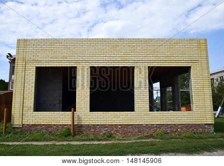 House Under Construction From Yellow Bricks