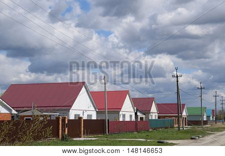 The Roof Of Corrugated Sheet On The Houses