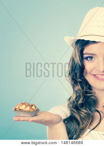Sweet food sugar make us happy. Attractive woman summer clothing holds cake in hand filtered photo