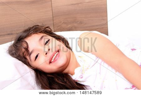 girl ready to sleep in her bed