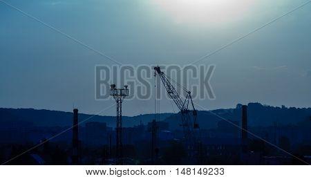 arm crane on construction site during building