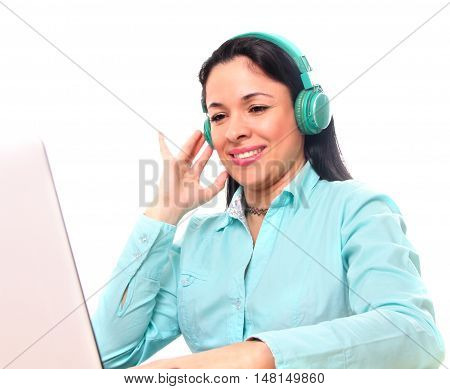 woman listening to music with headphones while working
