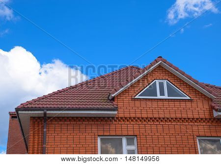 The House With A Roof Of Classic Tiles