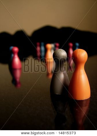 Concept of a multi-colored crowd people with small figures