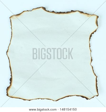 sheet of paper with burnt edges on a light backgrou