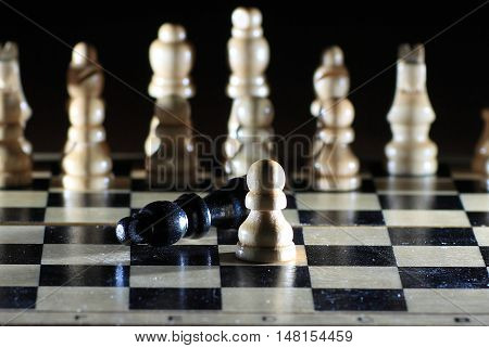 Composition with figures on a chess Board on black background