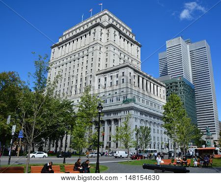 MONTREAL QUEBEC CANADA 09 17 2016: Sunlife building in Montreal canada.The Sun Life Building is an historic office building at 1155 Metcalfe Street. Place ville Marie in background.