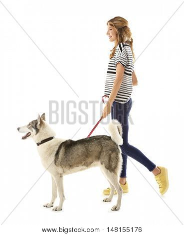 Young beautiful woman with husky isolated on white