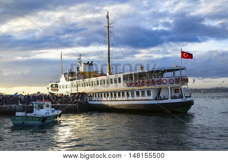 Istanbul Turkey - January 19 2013: Ferries in Istanbul. Boats have traversed the waters of the Bosphorus for millennia and until the opening of the first Bosphorus bridge in 1973 were the only mode of transport between the European and Asian halves of Ist
