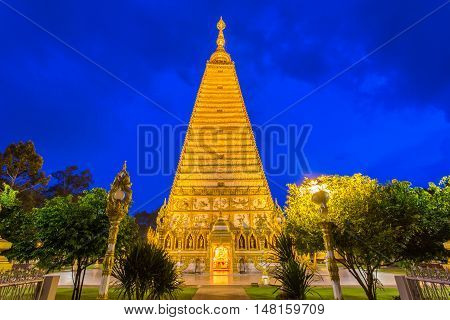 Beautiful pagoda Wat Phrathat Nong Bua Temple in night time at Ubon Ratchathani Thailand