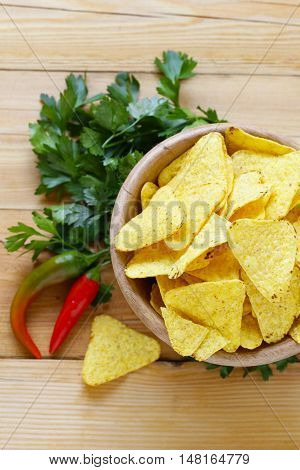 corn chips, nachos in a bowl on the table