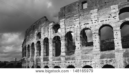 Coliseum with beautiful winter clouds in Rome (B/W)