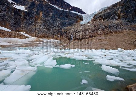 Green water in alpine lake under Angel Glacier at Mount Edith Cavell. Jasper National Park. Canadian Rockies. Alberta. Canada.
