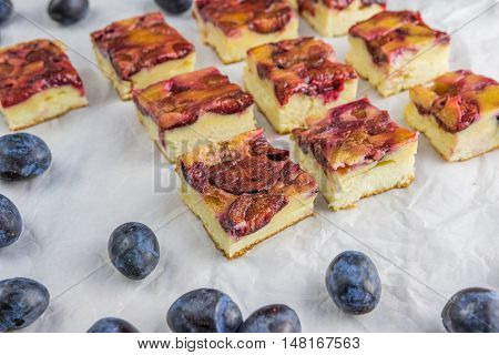 Plum Cake With Cinnamon On Baking Paper