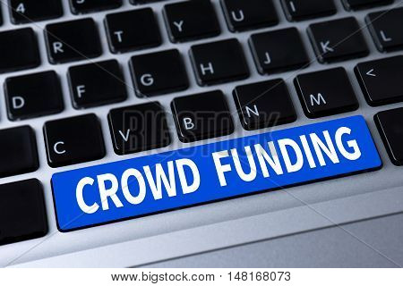 CROWD FUNDING a message on keyboard man work use computer