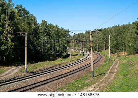railroad with a turn in a summer day