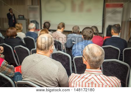 People In A Conference Hall Acting On The Besiness Presentation