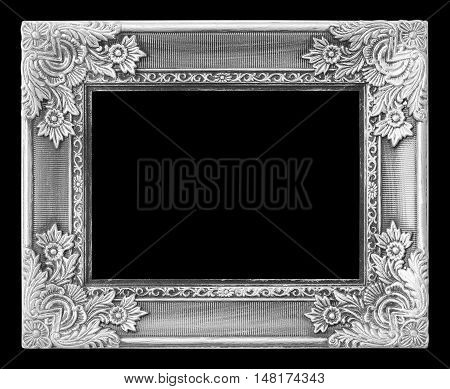 Old antique silver frame on the black background