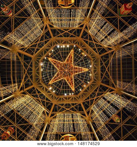 Main hall star ceiling in Gaylord Texan hotel at Christmas time. Bellow or floor view. Three image panorama.