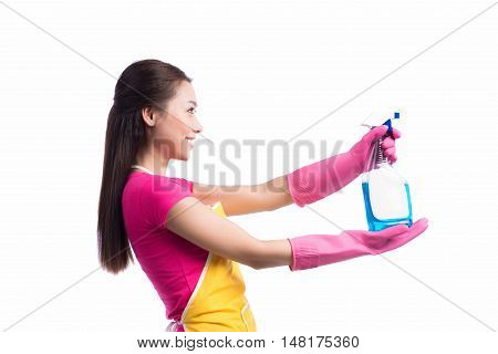 Portrait of a beautiful girl with a detergent for cleaning