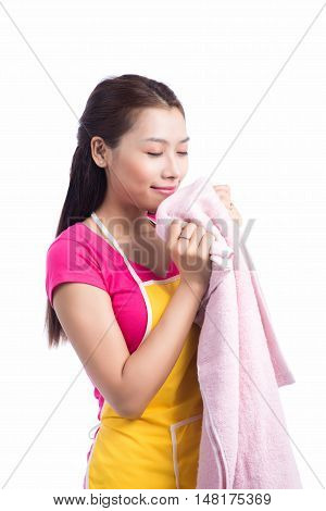 Young Asian Woman Crouching With Cleaned Clothes