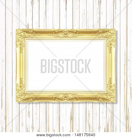 Antique gold frame on wooden wall ;. Empty picture frame on wooden wall.
