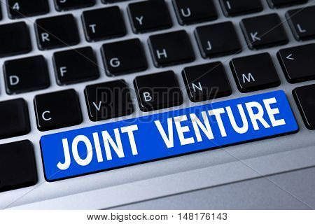 JOINT VENTURE a message on keyboard businessman working