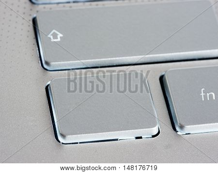 Blank silver button on laptop keyboard. Empty key button with copy space for message. Extreme close up