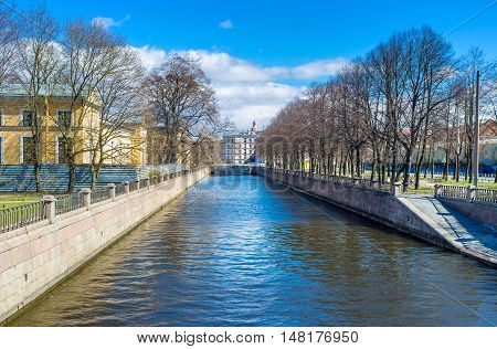 The stone banks of Griboedov Canal with the small park in Sadovaya street St Petersburg Russia.