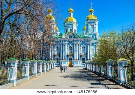 ST PETERSBURG RUSSIA - APRIL 25 2015: The blue-white facade of Baroque Naval Cathedral of St Nicholas (Sailors' Cathedral) with the golden domes located in Glinki street on April 25 in St Petersburg.