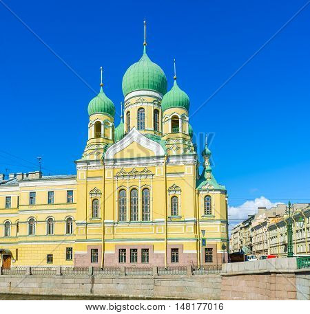 The restored St Isidore of Juriev Church with the green domes located at Giboedov Canal in Lermontovsky Prospekt St Petersburg Russia.