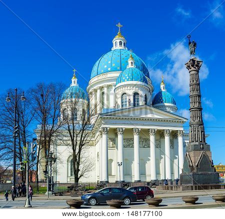 ST PETERSBURG RUSSIA - APRIL 25 2015: The memorial Column created of cannons replicas with the Goddess Nike on the top at the facade of Trinity Cathedral in Izmailovsky Prospekt on April 25 in St Petersburg.