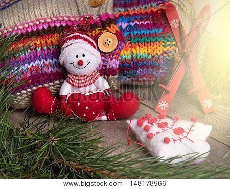 Christmas tree decoration snowman wooden texture background woolen warm wear new year