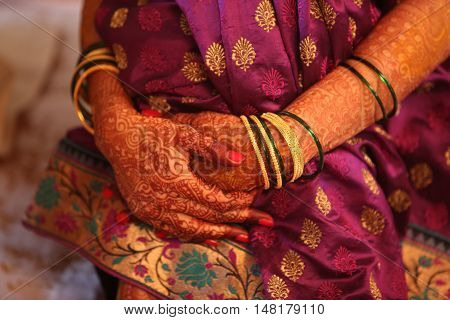 A metaphorical image of a waiting Indian bride with traditional attire.