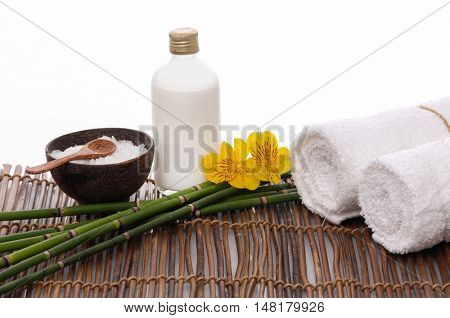 Spa resort - gorgeous orchid ,salt in bowl and towel ,oil on mat
