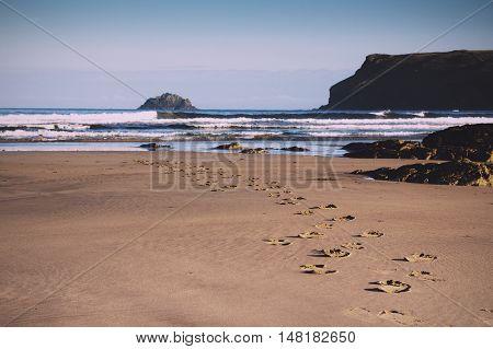 Footprints In The Sand On Polzeath Beach Vintage Retro Filter.