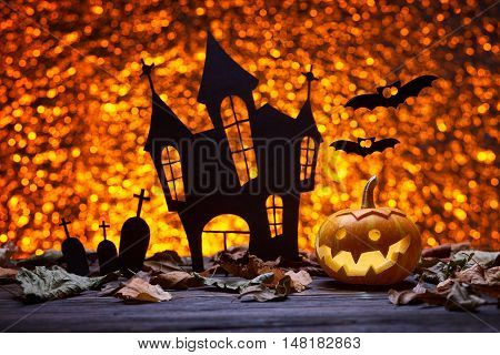 Pumpkin for Halloween, lamp pumpkin, antique wood, bat silhouette, celebrating halloween, smiley on pumpkin, silhouette of the cemetery, silhouette of the castle, autumn dry leaves, bright background