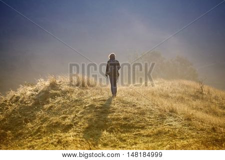 Photographer taking photos in autumn mountains in sunrise
