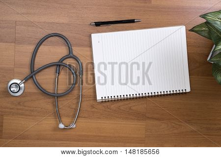 Top View Of Modern, Sterile Doctors Office Desk. Medical Accessories On Table