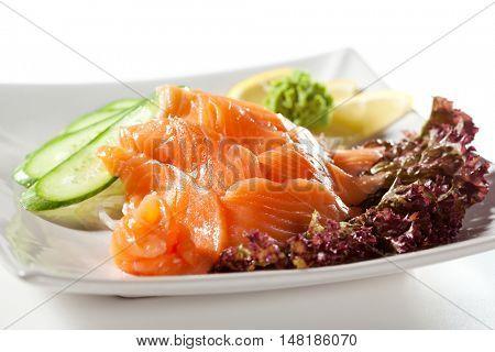 Salmon Sashimi - Sliced Raw Salmon on Daikon with Seaweed and Cucumber