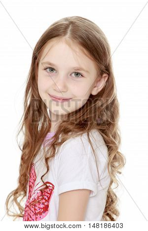 Beautiful little girl with long brown hair to her waist . The girl smiles sweetly turning sideways to the camera. Close-up - Isolated on white background