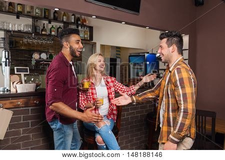Two Man Greeting Hand Shake, Friends Meeting Hold Orange Juice Glasses, Happy Smiling Sitting At Bar Counter