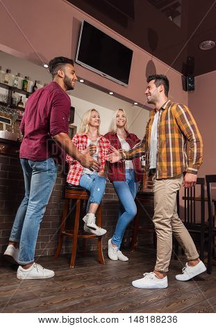 Two Man Greeting Hand Shake, Friends Meeting Full Length, Happy Smiling Sitting At Bar Counter