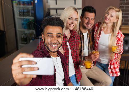 People Friends Taking Selfie Photo Drinking Orange Juice, Sitting At Bar Counter, Mix Race Man Hold Smart Phone Happy Smile Communication