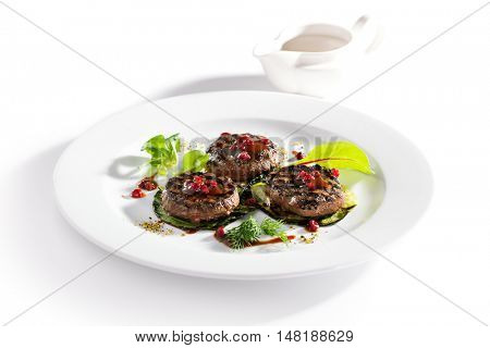 Grilled Meat Medallions with Berries Sauce and Fried Zucchini