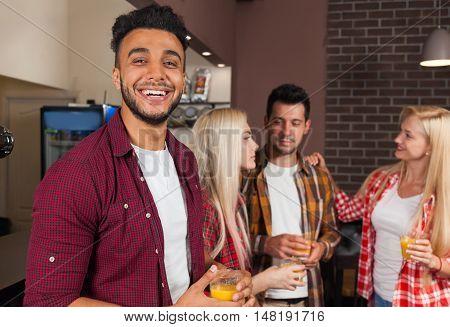 People Friends Drinking Orange Juice Talking Laughing Sitting At Bar Counter, Mix Race Man Happy Smiling Communication