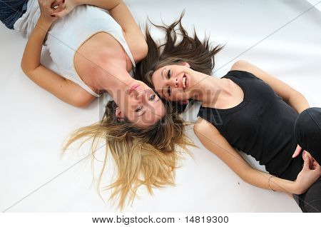 young woman with beautiful face lie on floor isolated closeup
