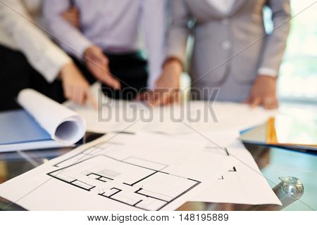 Blueprint of house on tablet of real estate broker