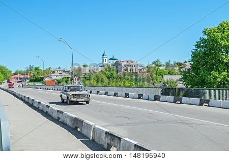 Bohuslav Ukraine - May 08 2014: View of a small provincial town with a bridge on a sunny spring day