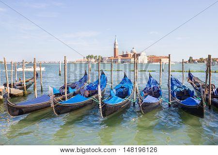 Many gondolas in a canal of Venice, Veneto, Italy